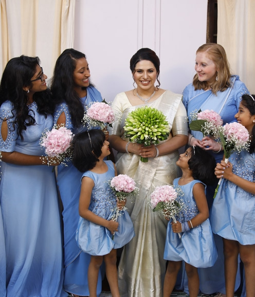 Bridesmaids in Ice Blue Ensembles