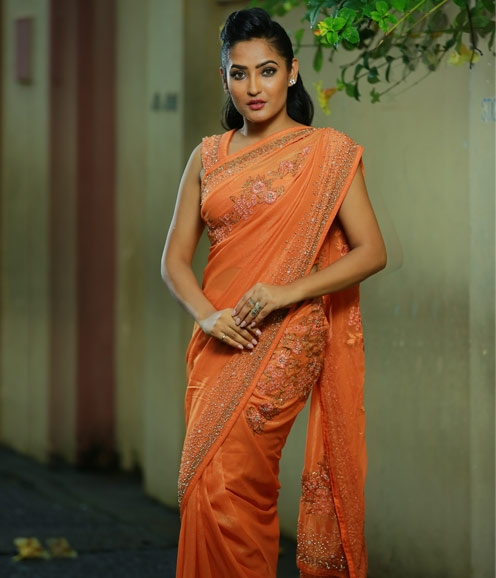 Orange Georgette saree adorned with sequins and beads