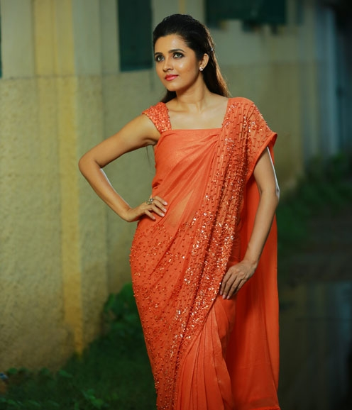 Orange Georgette saree adorned with pearl clusters