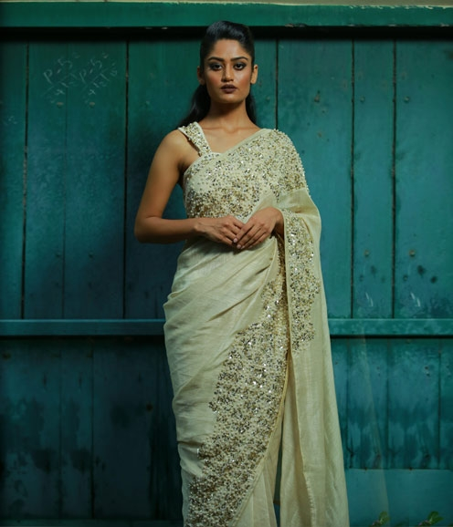 Off white linen saree with pearl highlights