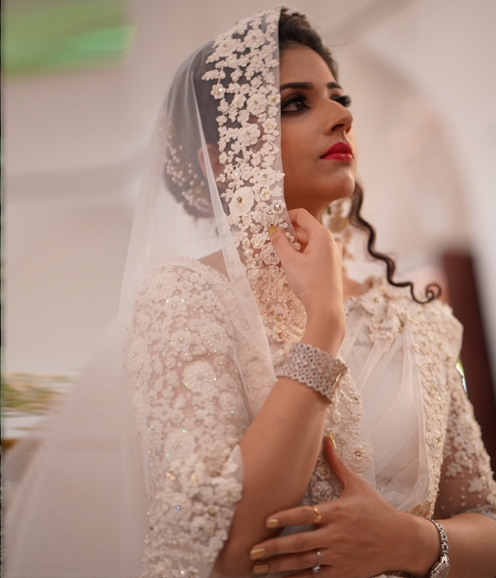 Christian white bridal net  saree with floral work on borders and intricate detailing on blouse