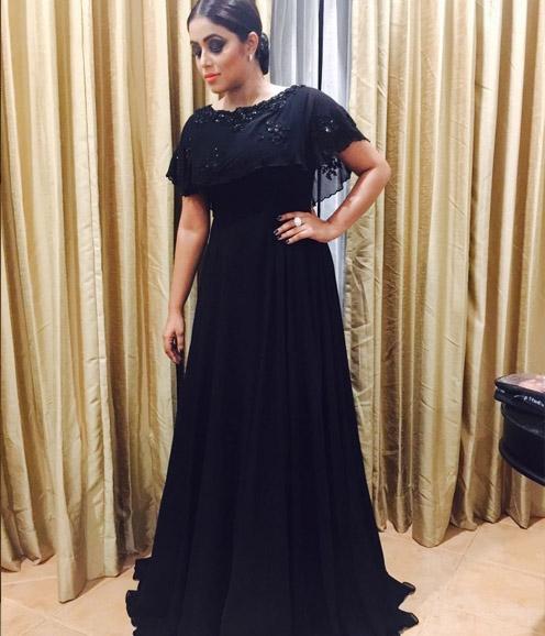 Shamna Khazim in Black Cape gown