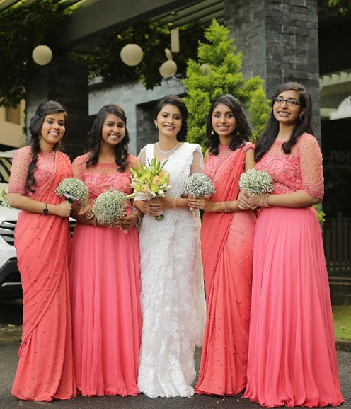 Bridesmaids in Peach Saree Ensembles