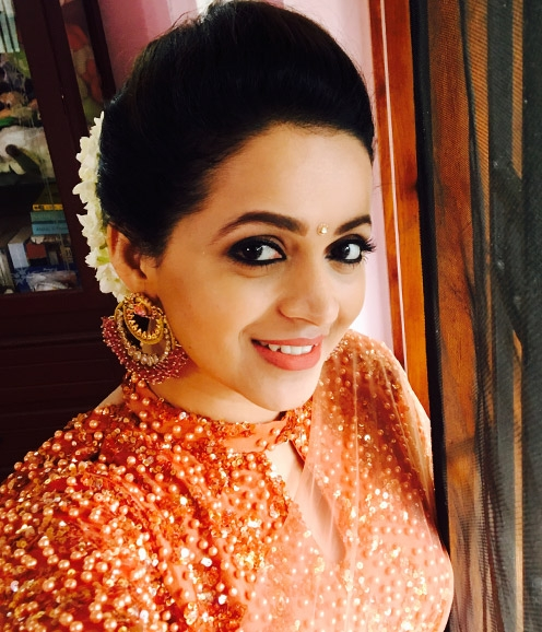 Bhavana in Coral Shade Lehenga Saree