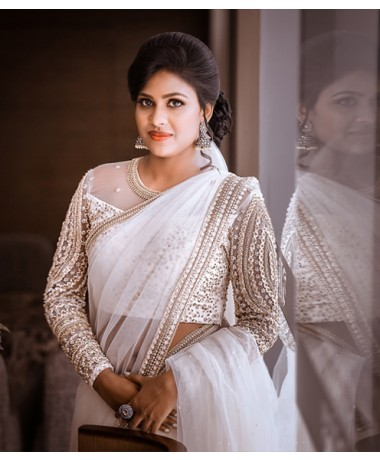 Christian ivory net saree with chikankari work on borders and geometrical pattern on sleeves