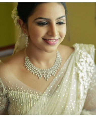 Christian White Bridal Saree with Trial Adorned and Floral Handwork