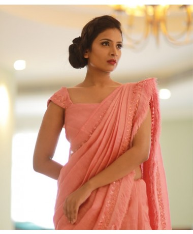 Pinkish Peach Linen Saree with feather highlights.